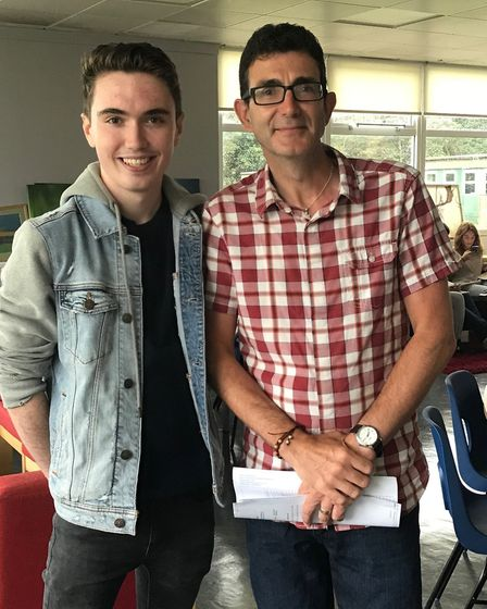 Rhys Jose with his English language teacher Mr O'Connor after picking up his A-level results from St