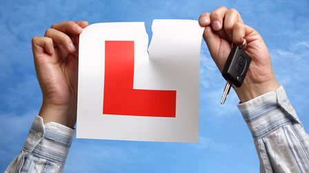 Tearing up L plate after passing driving test