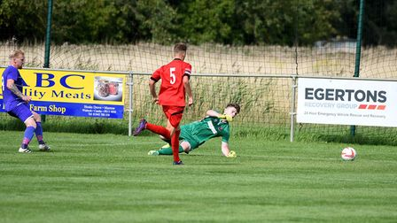 Nick Davey gives Wisbech St Mary the lead in their 3-1 success over AFC Sudbury Reserves. Photo: IAN