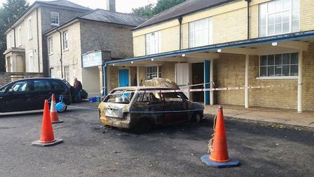 Arsonists torch a Rover that was left parked outside the church hall of St Peter's and St Paul's Chu