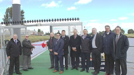 Councillor Ralph Butcher cuts the ribbon to officially open the new Crosskeys Marina, with fellow me
