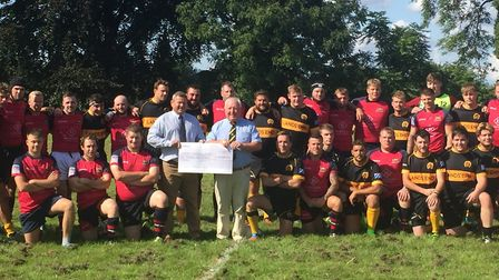 The cheque was handed over by Wisbech chairman Leonard Veenendaal (left) to Oakham Rugby Club past