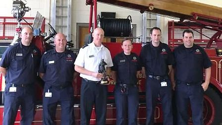 Phil Pilbeam with the current Wisbech crew in front of vintage fire engine Vivien.