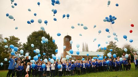 Pupils of Homerswood School celebrate the fact that the school has been awarded 'Centre of Excellenc