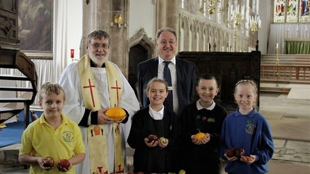 Village children celebrate harvest with songs, poems and art