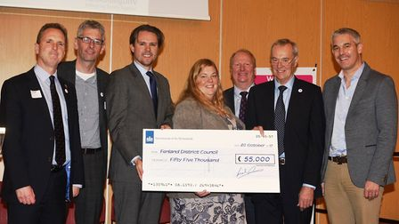 Matthijs Hou?t, Senior Commercial Attach? at the Dutch embassy in London presents the cheque at the