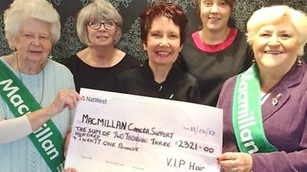 VIP Hair's Linda Pepper (centre) and staff members (back) present a cheque for £2,321 to representat