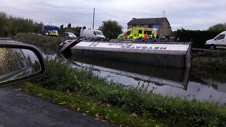 Driver escapes injury after his lorry rolled into the river at Outwell following a crash. PHOTO :Cou