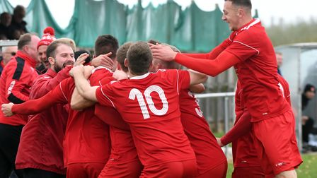 Wisbech celebrate one of their goals in their 4-0 FA Vase win over Felixstowe & Walton United. Photo