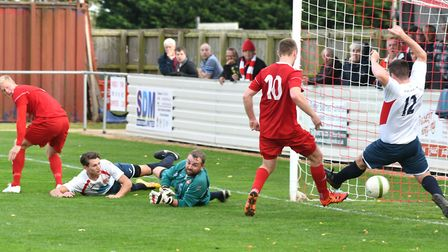 Alex Beck scores Wisbech's fourth in their 4-3 win over Northampton ON Chenecks. Photo: Ian Carter
