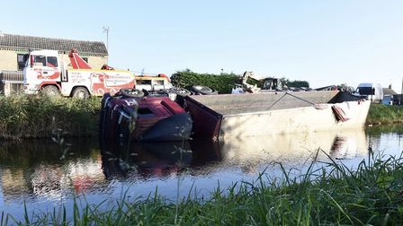 Work will begin today to remove this Heygates of Downham Market lorry from the river at Outwell. It
