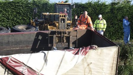 Rescue workers are attempting today to lift this Hegyates of Downham Market from Well Creek at Outwe