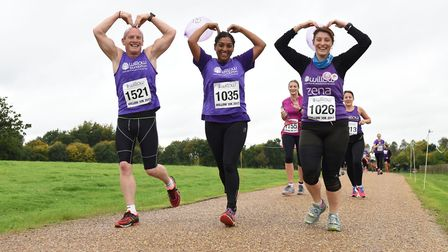 Three runners copy Mo Farah's Mobot during the Willow 10K [Picture: Christopher Dean / Scantech Medi