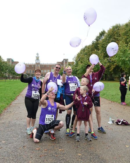 Lisa Langford's husband Adam and sons releasing balloons for Lisa at the Willow 10K [