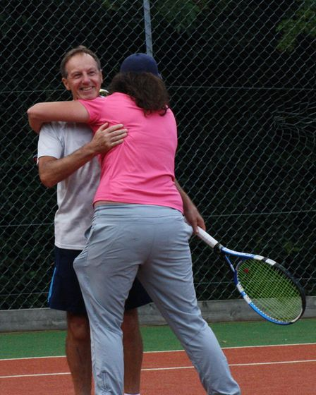 Mel De Hann celebrates with John Conway after the pair won the mixed doubles at Potters Bar Tennis C