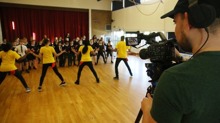 Sky TV cameras film ChrissyB from the ChrissyB show and her dance crew as they teach the year six pu