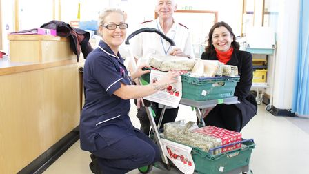 Queen Elizabeth Hospital, King's Lynn.Oxborough Ward Manager Michelle Lawrence receives the presents