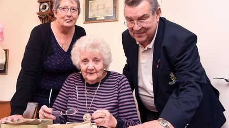 A biscuit tin of photographs and medals of a local soldier is reunited with his sister Molly Auger i