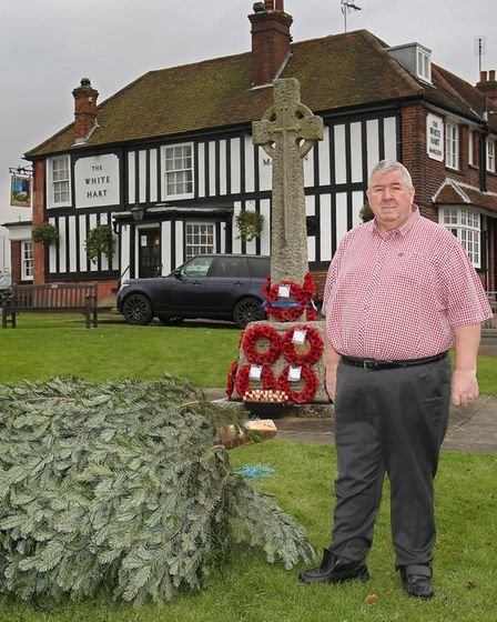 Potters Bar councillor Martin Worster next to the South Mimms Christmas tree which vandals have chop