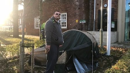 Kieran Bagstaff with his test while protesting outside the Welwyn Hatfield Borough Council offices.