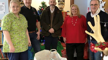 Marshland group members with gifts, Wes Attwell, Matt Green, Wendy Ferguson and Philip Kew with staf