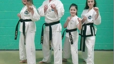 Students at the Carter Schools of Taekwondo have gained their 1st Dan black belt. (left to right) El