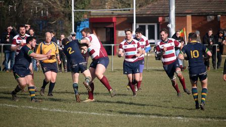 Welwyn's Will Freeston wrestles for possesion with Kilburn's Tom Ding. Picture: Kevin Lines