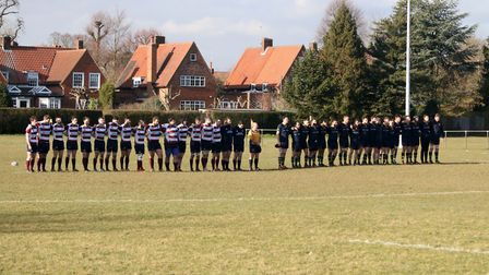 Teams observe a minutes silence before kick off. Picture: Kevin Lines