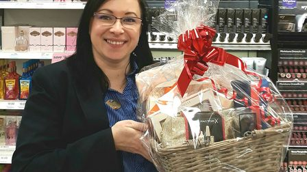 Monika Thompson, assistant store manager of Boots in the Horsefair, displays the Valentine's Day Pam