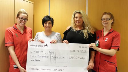 Cousins Lizzie Hurrell and Elaine Woods present cash to specialist nurses Charlotte Johnson and Ver