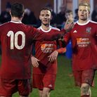 Wisbech Town players Alex Beck (10), Billy Smith (centre) and Michael Frew (right) celebrate during