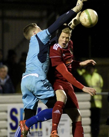Wisbech Town striker Michael Frew challenges the Yaxley goalkeeper. Picture: IAN CARTER