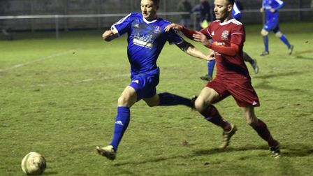 Wisbech Town man Billy Smith puts a Yaxley opponent under pressure. Picture: IAN CARTER