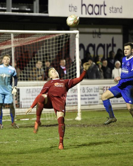 Wisbech Town striker Michael Frew gets in an acrobatic effort during their success against Yaxley. P