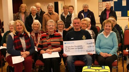 Members of Three Holes Acorn Club presented a cheque for £1600 to the local First Responders