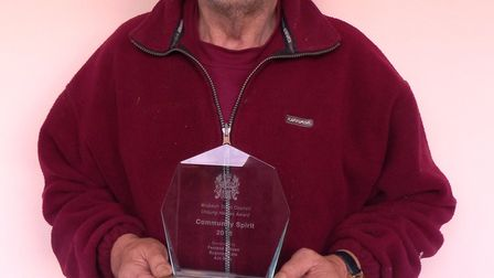 Trevor Kettering is given a community spirit award for volunteering at the Ferry Project