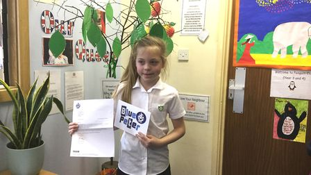 Lily Dickson of Tilney Primary School with her Blue Peter Badge