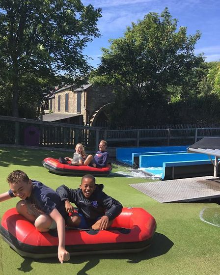 The headteacher (background) joins in the fun. Picture: Supplied by Cranborne Primary School