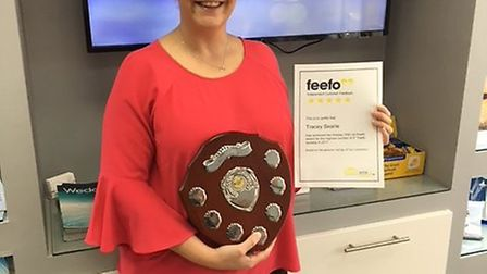 Tracey Searle with her Feefo gold customer service award.