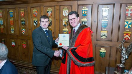 George Evans receiving his award from Vincent Keaveny. Picture: Gerald Sharp Photography