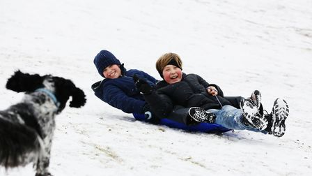 Oliver Banks (left) and Hector Dobney, both 10 have fun in the snow at the lagoon on Waterside, Welw