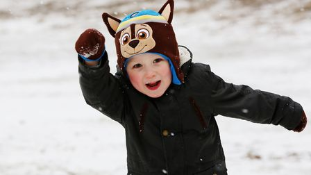 Brandon Loo, four, having fun in the snow at the lagoon on Waterside, Welwyn Garden City. Picture: D