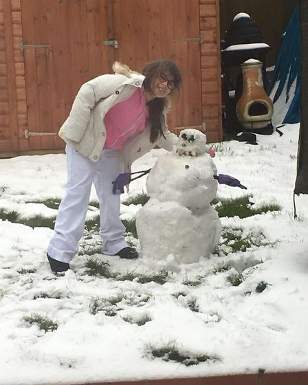 Eight-year-old Tilly from Welwyn Garden City built this snowman all by herself. Picture: Karen Onky