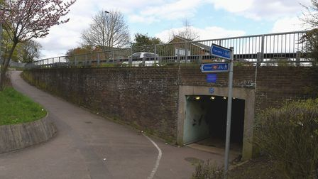 The blue commemorative plaque for Joseph Alfred Gunn in place above an underpass near Hatfield Train