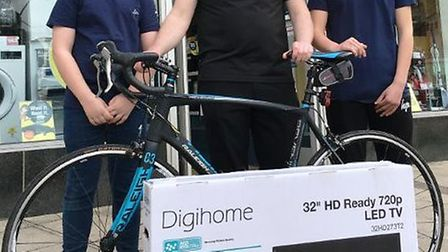 Hughes Electrical in Wisbech is helping two local students in their attempt to raise £8,000 to go on