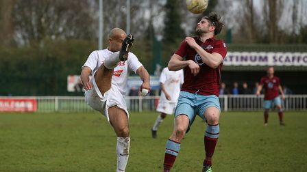 Ashley Kersey closes down a defender as he hooks the ball clear. Picture: DANNY LOO
