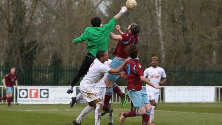 Ashley Kersey challenges for a corner. Picture: DANNY LOO