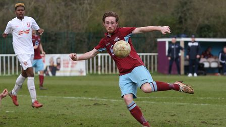George Ironton volleys towards goal. Picture: DANNY LOO