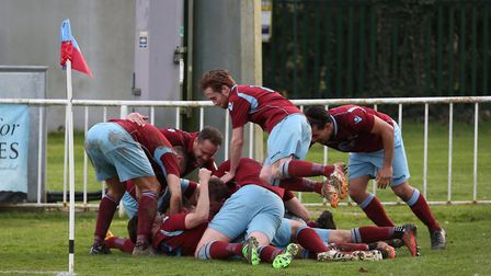 Welwyn Garden City players celebrate the winning goal which wins them the league. Picture: DANNY LOO