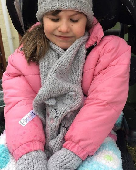 A Wisbech girl has received a specialist piece of equipment, to help with her conditions, from a chi